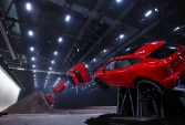 NOTE: IMAGE STRICTLY EMBARGOED UNTIL 20.00 BST, JULY 13th 2017. NO ONLINE USE PRIOR TO THIS TIME. Jaguar and stunt driver Terry Grant set a new Guinness World Record for longest barrel roll at the global launch of the new Jaguar E-PACE at ExCel London. (Image composite)